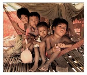 Four children sharing a hammock