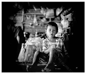 A khmer boy enjoying his sweet
