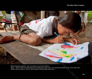 Khmer child concentrating on her coloring project with art materials donated to her by particiapnts of the 2nd PhotoMalaysia Photosafari Experience