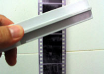 Carefully remove the film from the reel and hang it up to dry. Use the squeegee to remove excess water from the film and leave it to dry.