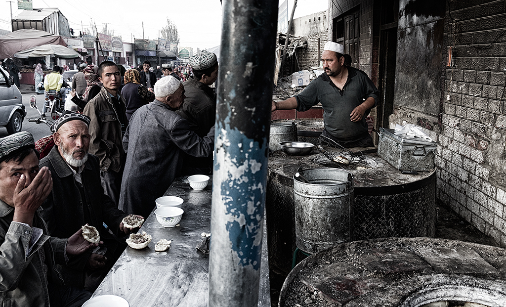 Street food vendor and his customers.