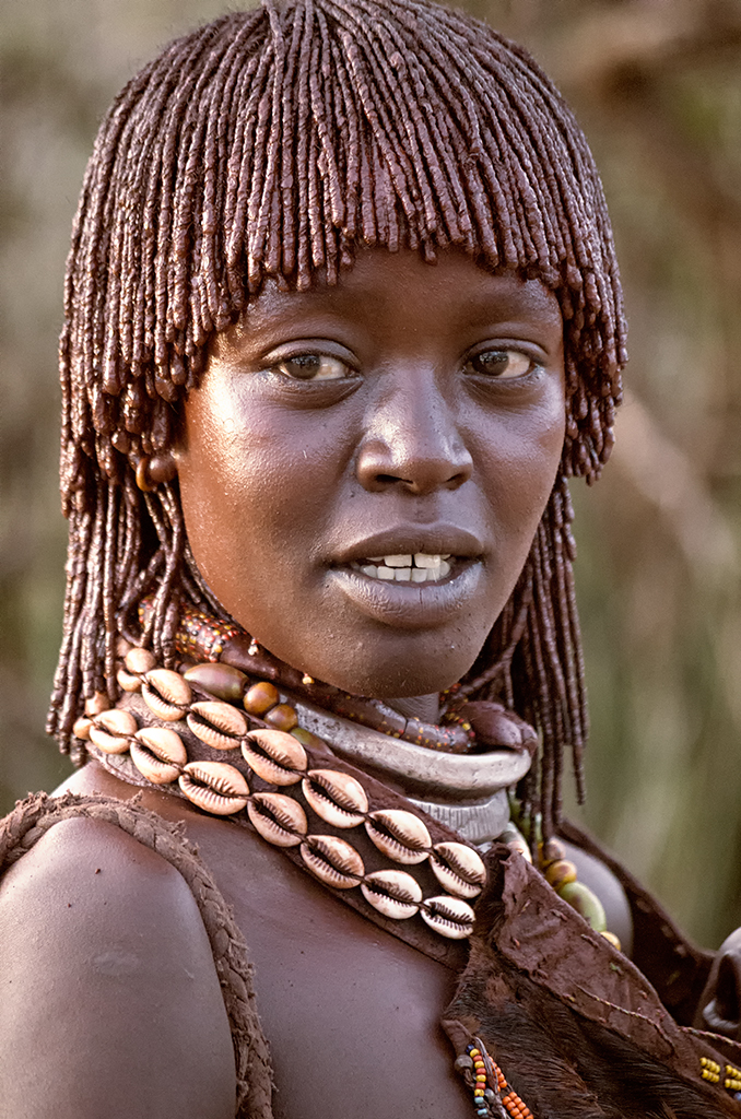 Woman from the Hamer Tribe with their pleated hair.