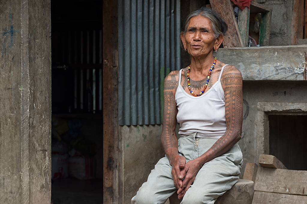 One of the many woman from the hill tribe village that decorate their bodies with tattoos crafted specially by Fang Od