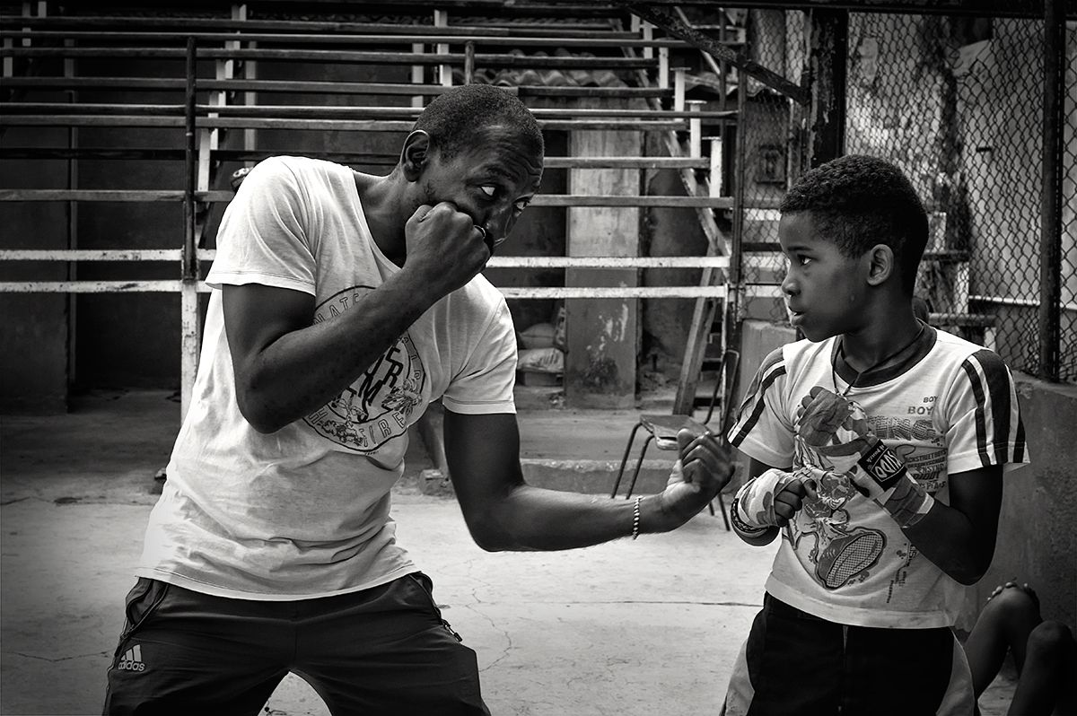Here, he is teaching one of the students the finer points of defending and attacking