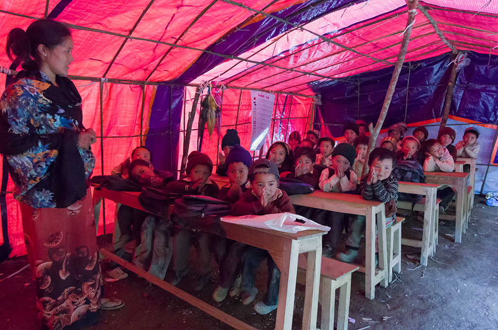 The children are still housed in tents after almost a year from the earthquake.