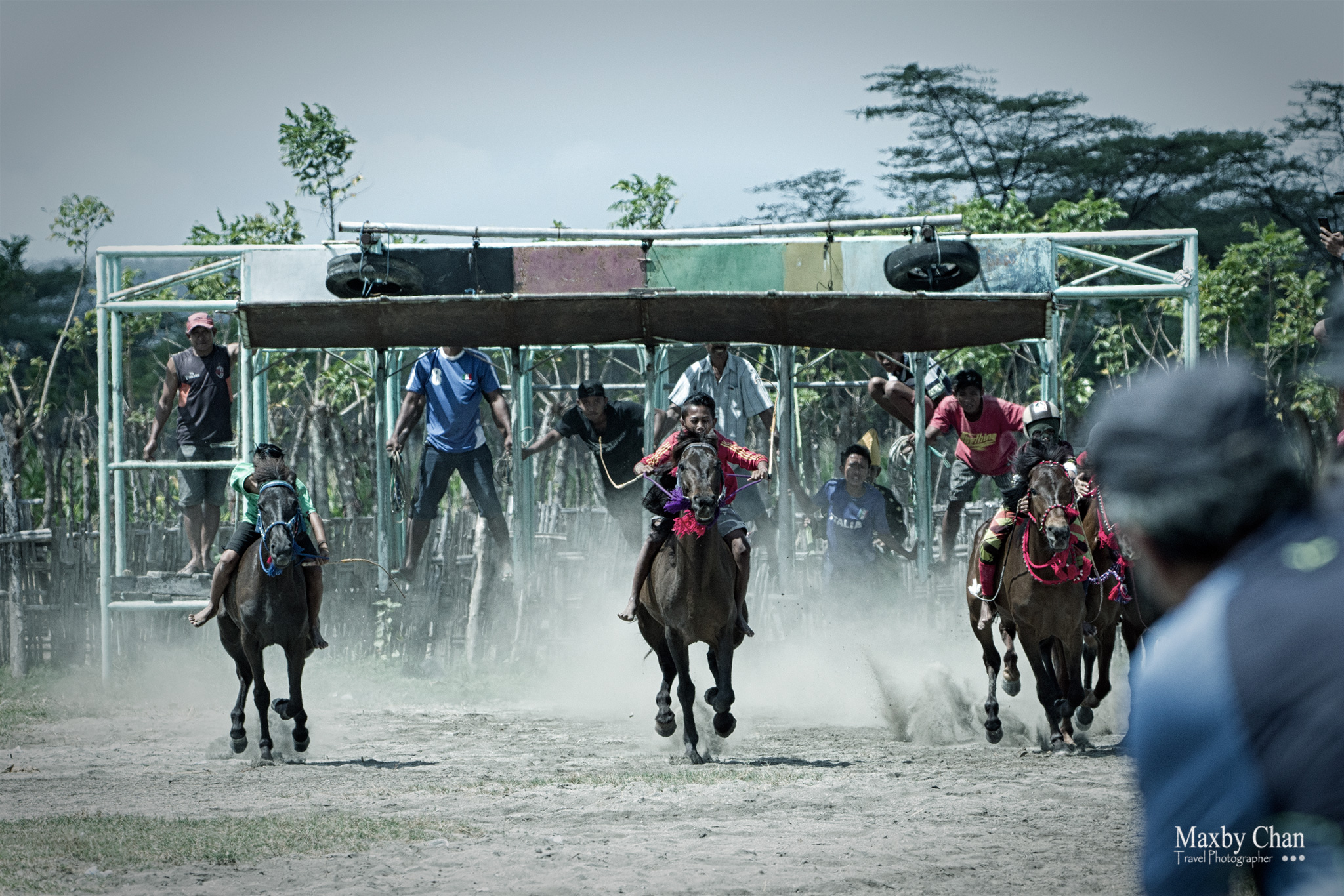 The start of the horse race at the gates.